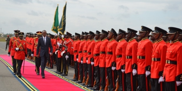 President Paul Kagame of Rwanda inspecting the Tanzania Peoples' Defence Forces parade in his arrival at terminal one of Julius Nyerere International Airport.