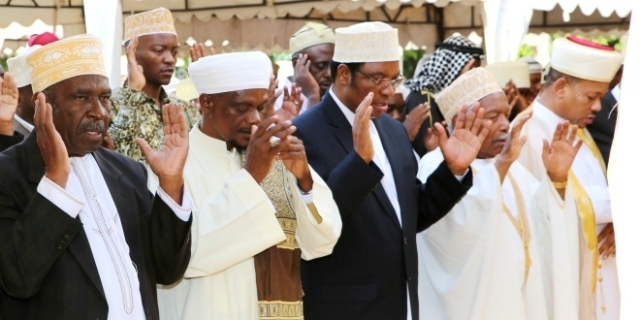 Prime Minister Kassim Majaliwa (C) takes part in Eid el Fitr prayer at Mnazi Mmoja grounds in Dar es Salaam yesterday. On his (L) is retired President Ali Hassan Mwinyi and on his (R) is Chief Sheikh of Tanzania Abubakary Zubery bin Ally. Photo: PMO