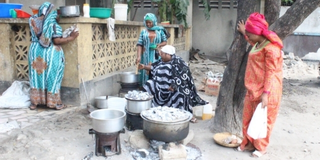 Women Prepare dish for their families and friends in Dar es Salaam yesterday. Photo: Mpoki Bukuku