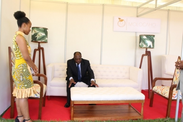 Industries, Trade and Investment Permanent Secretary Dr. Adelhelm Meru views some of the furniture manufactured by Amorette Limited.