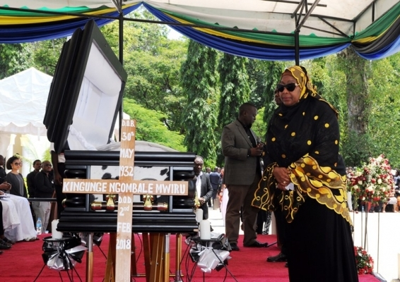 Vice President Samia Suluhu Hassan pays her last respects to Kingunge Ngombale-Mwiru at Karimjee grounds in Dar es Salaam yesterday, followed by hundreds of other mourners. The long-serving politician was buried in the city later in the day. Photos: John Badi