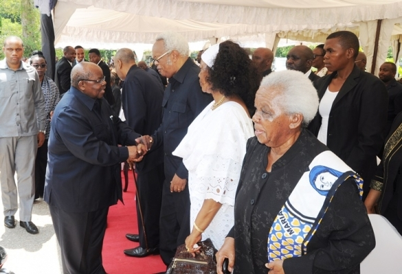 Former President Benjamin William Mkapa and former Prime Minister Edward Lowassa exchange greetings.