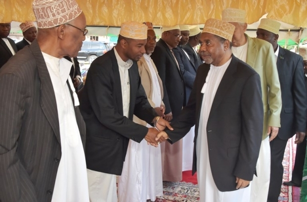 Zanzibar President Dr Ali Mohamed Shein exchanges greetings with sheikhs on arrival at Jamhuri Stadium at Makunduchi in Unguja South District yesterday for Eid el-Hajj prayers. Photo: Zanzibar State House