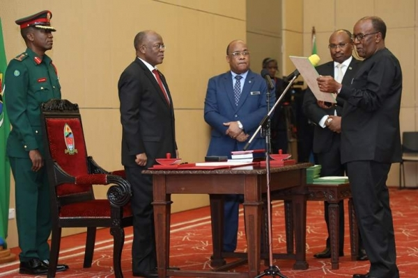 The President swears in Daniel ole Njoolay as a Commissioner in the Public Service Commission at State House in Dar es Salaam yesterday. Photo: State House