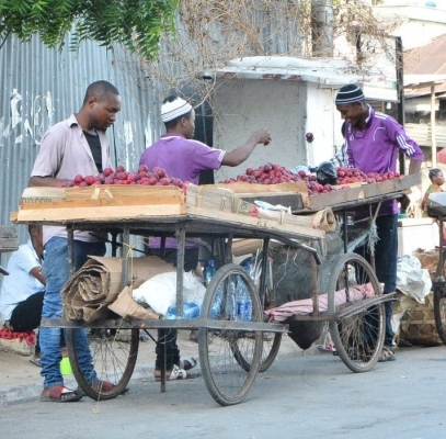Fruits vendors display their products waiting for potential customers along Congo Street at Kariakoo area in Dar es Salaam yesterday. Photo: Miraji Msala