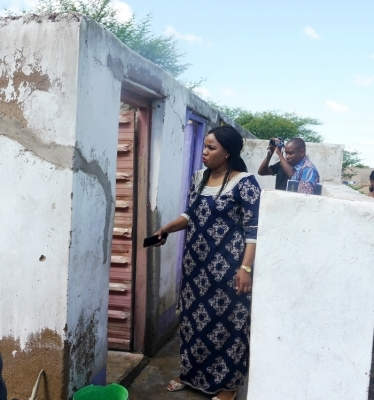 Shinyanga district commissioner Jasinta Mboneko inspects pupil's latrines which are in poor quality at Shy Moderm private primary school in the district o Thursday where the school has been deregistered due to the lack of criteria of primary education. Photo: Correspondent Marco Maduhu