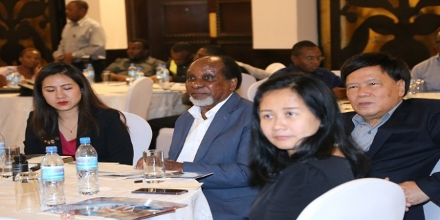 IPP Executive Chairman Dr Reginald Mengi and Dr Kampon Sriwatanakul (R) follow the presentation.