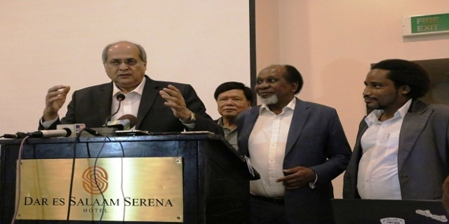Dr Alok Sharma Director of  NeuroGem Brain and Spine Institute from Mumbai India speaks at the workshop in Dar es Salaam. Others from (L) are Dr. Kampon Sriwatanakul, Dr Reginald Mengi and Dr Michael Magoti. All Photos: Selemani Mpochi