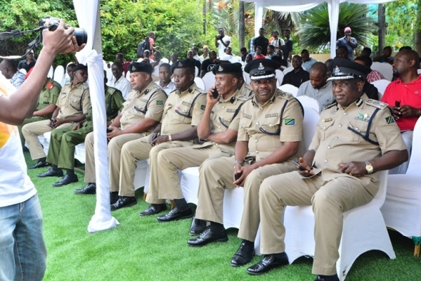 Police officers sit at Dr Mengi's house in Dar es Salaam yesterday. Photo: Correspondent Miraji Msala