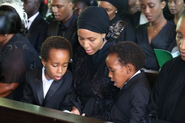 Jacqueline, the widow of Dr. Mengi with her sons Ryan and Jayden at the requiem mass.