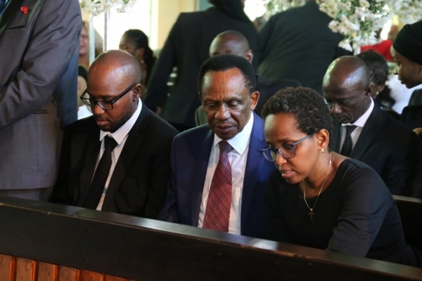 Dr. Mengi's daughter Regina and son Abdiel with uncle Benjamin Mengi (C) at the requiem mass.