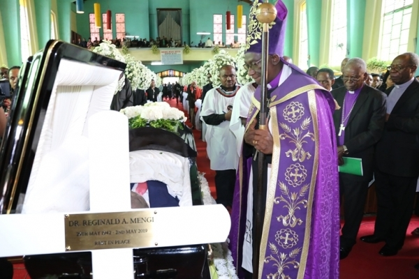 Head of the Evangelical Lutheran Church in Tanzania (ELCT), Bishop Dr Fredrick Shoo pays his last respects.