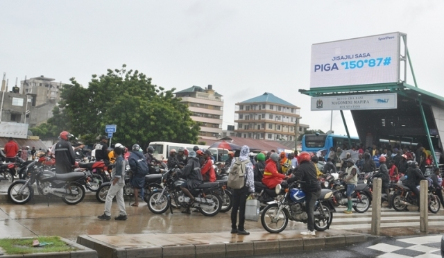 Tricycle riders or 'Bodaboda' gather at the Magomeni Mapipa Rapid Transit bus stop along Morogoro Road in Dar es Salaam yesterday looking for passengers after the Jangwani area was closed to rapid transit buses following a prolonged downpour and flooding. Photo: John Badi