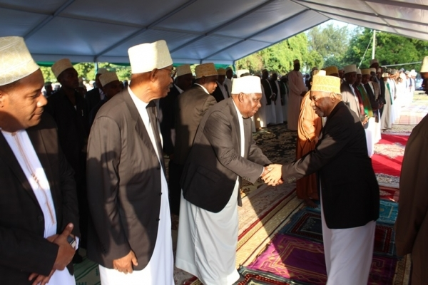 Zanzibar President Dr Ali Mohammed Shein and Second Vice President Seif Ali Iddi exchange greetings shortly after Eid el Fitr prayers in Zanzibar yesterday. Photo: Zanzibar State House