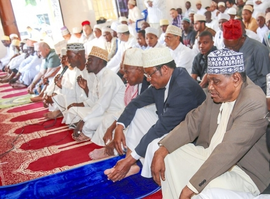 Prime Minister Kassim Majaliwa joins other Muslim faithful in Eid el Fitr players at Dar es Salaam's Anwar Mosque yesterday. Photo: PMO