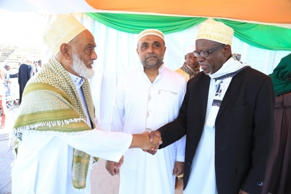 Sheikh Mohamed Thabit (R) blesses Ismail Dawood shortly after Eid el Fitr prayers in Dodoma city yesterday. Photo: Correspondent Ibrahim Joseph