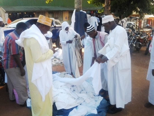 Residents of Muheza Town in Tanga Region sort out second-hand cassocks after Eid el Fitr prayers yesterday. Photo: Correspondent Steven William