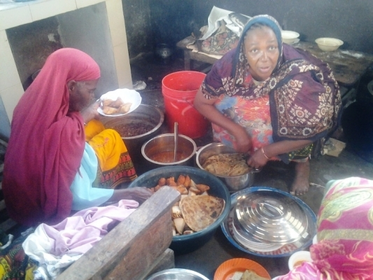Muheza Town resident 'Mama' Habiba (R) prepares food for Eid el Fitr sale yesterday.  Photo: Correspondent Steven William