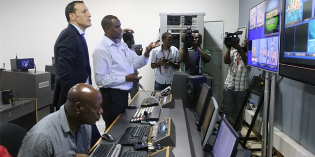ITV/Radio One channel director Macharia Koigi (gesturing) briefs Tigo chief commercial officer Tarik Boudiaf, who visited IPP media houses in Dar es Salaam yesterday.