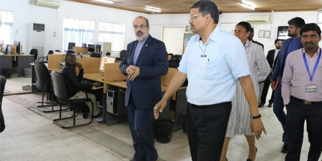 Ambassador Farhang (L) is shown around The Guardian Limited newsroom, led by GM Chintaruri. Right is TGL commercial director Ajay Goyal.