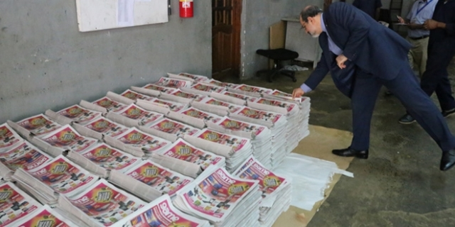 The ambassador skims through an advertisement pullout at the company's printing unit.