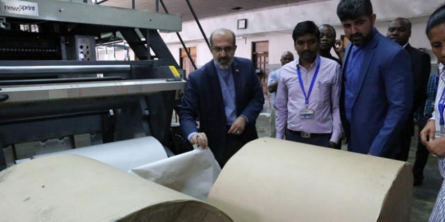 Ambassador Farhang has a feel of newsprint and other printing material stocked at the TGL printing unit.
