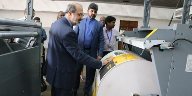 Ambassador Farhang, who showed keen interest in newspaper work, is taken around the TGL printing unit. Photos: Selemani Mpochi