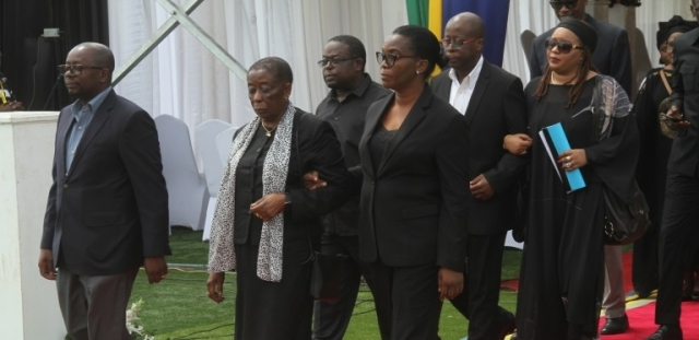 The former president's widow, Anna Mkapa, leads the Mkapa family into Uhuru Stadium for the solemn service. Photo: Jumanne Juma