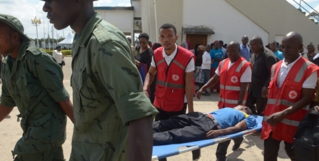 Tanzania Red Cross attendants and Members of the National Service come to the help of a mourner who passed out while paying his paying his last respects. Photo: Jumanne Juma