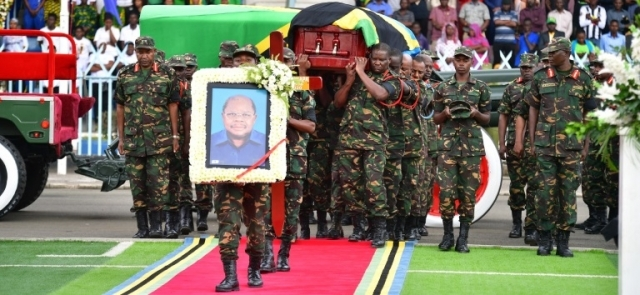 Tanzania People's Defence Force officers carry the casket bearing the body of former President Benjamin Mkapa ready for the solemn ceremony. Photo: State House